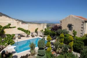 Outdoor view of garden & pool from Ontas Classic Suite